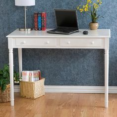 Boasting a slim design in crisp white with carved spindle legs, our hardwood office desk blends traditional style with a country-chic appeal. Featuring a wide desktop with two deep supply drawers, this versatile writing or computer desk is finished on all four sides for placement anywhere in a room.