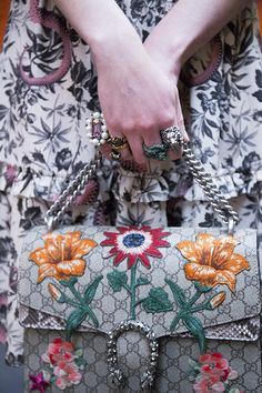 Rings with flowers and lions and a  Gucci embroidered Dionysus bag.