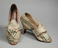 Women's shoes, c. 1780, possibly English, brocaded silk taffeta lined with linen and bound with ribbon, leather sole and insole. LACMA