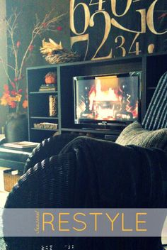 Even warm-weather climates enjoy #decorating for #Fall: Turn your TV into a fireplace with a screen saver & complete your seasonal change draping a cozy throw from HomeGoods on an arm chair - Lynda Quintero-Davids #HomeGoodsHappy #sponsored
