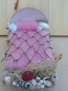 Mermaid miniature bed with shell headboard, pink. $25.00, via Etsy.