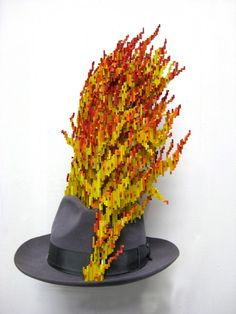 """Schrodinger's Hat"" (2009)   Bass wood, ink, gauche, acrylic paint, felt Fedora  10 inch diameter x 22 inches"