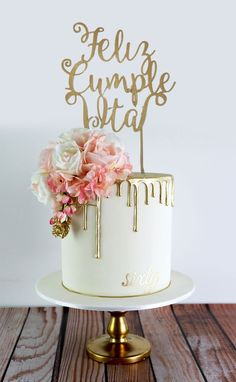 Classy and elegant golden drizzle 60th birthday cake with a pretty