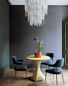 Chandeliers are like jewelry that finishes a beautiful room. This 70's murano ice against beautiful steel gray grasscloth walls is the perfect way to to add that extra hint of glamour.