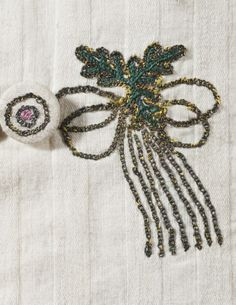 Detail embroidery, vest, England, circa 1790. White cotton plain weave and twill with silk and metallic-thread embroidery and printed-cotton plain-weave trim.
