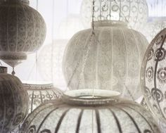 White Moroccan pierced metal lanterns... Imports from Marrakesh has a new collection of these lanterns in many sizes { via Lonny magazine}
