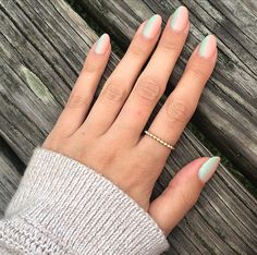 An ombre manicure using CND™ SHELLAC™ brand 14+ day nail color in Mint Convertible and Salmon Run shades can brighten up any vacation!