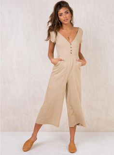 db3f2750586 Seven+Days+Jumpsuit+-+ Cropped+jumpsuit Button+up+bust Twin+front+pockets  Invisible+zip+fastening+downside Relaxed+cropped+leg  Textured+lightweight+material ...