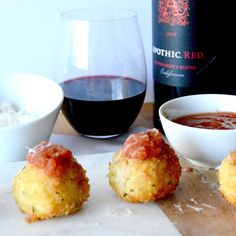 Gruyere Salami Risotto Balls (Arancini): An easy appetizer to make from leftover risotto. These Arancini balls are filled with a melty, stretchy Gruyere cheese and a spicy salami. Those are surrounded by risotto that is rolled in panko and fried for a crunchy bite of deliciousness!