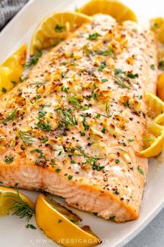 Salmon Baked salmon recipe seasoned with garlic, roasted lemons, and fresh herbs. A healthy family dinner ready in just 30 minutes.Baked salmon recipe seasoned with garlic, roasted lemons, and fresh herbs. A healthy family dinner ready in just 30 minutes. Fish Dishes, Seafood Dishes, Seafood Recipes, Dinner Recipes, Cooking Recipes, Healthy Recipes, Healthy Food, Healthy Chips, Dinner Menu