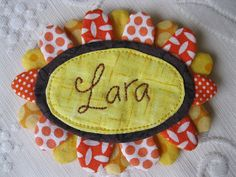 Quilted name tag idea for 3 dimensional fabric frame