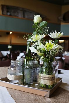 These would be great as centerpiece accessories or to place at the gift tables, etc.  #flowers #rustic #wedding