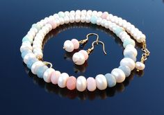 Handmade necklace and earing set using White Freshwater Cultured Button Pearls and natural coloured handfaceted Opals. It is finished with Yellow Gold on Sterling SIlver. Nickel and Lead Free. Handmade in Roscommon, Ireland. Opal Earrings, Opal Necklace, Roscommon Ireland, Handmade Necklaces, Handmade Jewelry, Opals, Pearl White, Lead Free, Earring Set