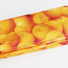 Citrus Oranges Cotton Napkins (Set of 4) ME2Designs Handmade Table Decor. The handmade fresh citrus oranges napkins are a great way to add a punch of visual Vitamin C to your breakfast table decor! The eco-friendly citrus napkins are a great idea for a sunny bright gift under $50! The oranges could be from anywhere, but I chose to imagine them as Florida oranges because we (in Florida) are blessed to have the ability to walk outside and pick oranges right from our trees (super freshness)!...