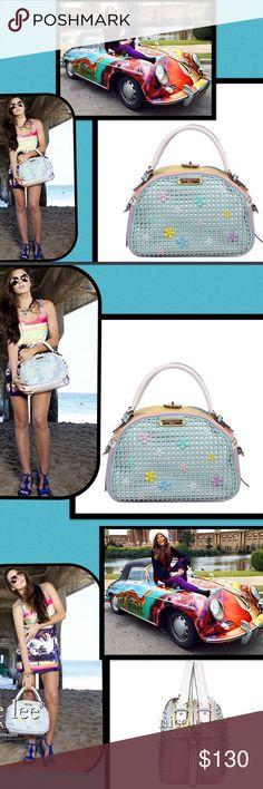 """🆕Nicole Lee🌺Floral 🌸Pastel Laser Cut Bag🌷 Be Fun🌺& Flirty in the Summer Sun🌸array of floral & pastel colors💐 laser cut design at front/back,🌺clear rhinestones at front,metallic leather trim🌺2 main zipper compartments🌸dual top handles🌷metal zipper closure🍄NL logo monogram zipper puller🍄turnlock closure💐back zip pocket Nicole Lee signature logo nameplate🌻imside zip wall pocket w/NL nameplate double open wall pockets 🌺geometric print with NL logo satin lining handles w/5"""" drop…"""