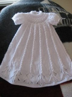 Cabled Yoke Christening Gown - free pattern by Judy Lamb - There are matching booties and bonnet on the same link
