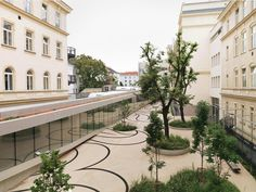 """Metamorphosen von Raum und Zeit"", by artist Maria Hahn Kamp with architect Willi Frötscher, on sand-colored asphalt was a black Ornament linear about the entire length plotted as a ""time-track"""