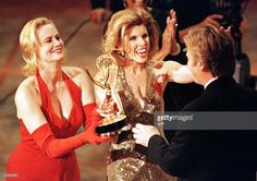September 8, 1996 -- Actresses Cybill Shepherd (L) and Christine Baranski (C) present an Emmy to Alan Rickman (R) for outstanding lead actor in a mini-series or special for his lead role in the HBO production of 'Rasputin' during the 48th Annual Emmy Awards 08 September in Pasadena, California. AFP PHOTO/Vince BUCCI