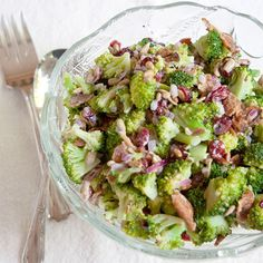 Broccoli salad featuring crisp, fresh broccoli florets, bacon, dried cranberries, and sunflower kernels with a sweet and tangy dressing.