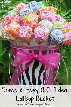 Here's a cheap and easy gift idea that's sure to sweeten someone's day: Make an adorable lollipop bucket! This is a great gift idea for friends, teachers, kids, or just to make as a cute centerpiece!