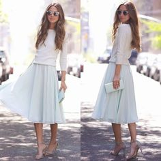 Ladylike simplicity in style with a sweater skirt combination.