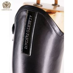 Alberto Fasciani 32000 horse riding boots have front laces and are made from black calfskin leather with a shiny logo badge tab. Alabaster Skin, Alberto Fasciani, Horse Riding Boots, Red Wedding Dresses, Feminine Energy, Horses, Annie, How To Wear, Leather