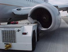 Continental Airlines Boeing 737 engine strike with aircraft tug