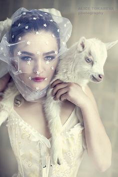 By Alice Tokareva. Almost thought, for a brief moment, that the lamb's ear was a unicorn horn. Love her veil too.