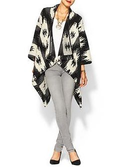 This Boho knit jacket and grey skinny jean outfit is great for working in the studio. While it looks fashionable its also comfortable. It can be worn in many ways. Such as with a pair of shiny colored flats or with a pair of Mary Jane pumps. It would look really completed with a bold necklace from Forever 21. This could be worn in or out of the studio.