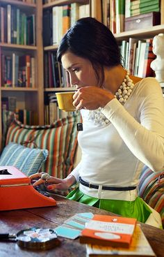 necklace, kelly green taffeta, orange typewriter, library bookshelves... i want it all.