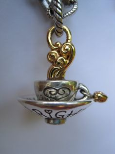 This Brighton teacup charm must be new. I have not seen it before but it is adorable. Perfect for a girl who channels the Brits & wishes she lived in Wonderland! ;)