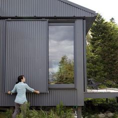 A Tiny Cabin is This Writer's Off the Grid Getaway - Photo 14 of 20 - When Alex or Bruce leave the island, closing up shop is as simple as sliding panels of corrugated metal into place to protect the windows. Metal Building Homes, Building A House, Building Ideas, Building Plans, Building Exterior, Architecture Durable, House Architecture, Sliding Panels, Sliding Doors