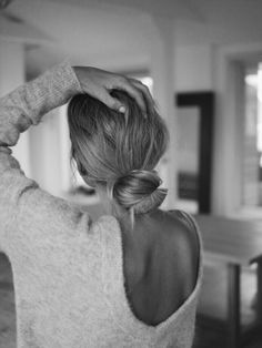 low bun and open back sweater