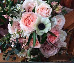 Fresh spring bouquet w/anemone black center!