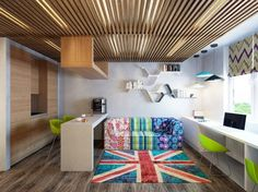 Apartments Colorful Living Room Design With Wood Laminate Flooring With Green Plastic Chairs The English Flag Rug With A Long White Table With Wooden Walls With Wooden Ceiling With Artistic Bookshelf Cheerful Apartments Decorating Ideas with Splashes of Color