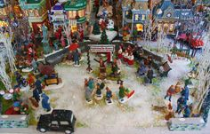 Christmas village display are a beautiful addition to any holiday home. They are often placed beneath the Christmas tree. Christmas In The City, Christmas Town, Christmas Scenes, Christmas Villages, Christmas Art, Beautiful Christmas, Christmas Lights, Christmas Holidays, Christmas Decorations