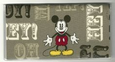 """Retro Disney Mickey Mouse on Brown Checkbook Cover by Tickled Pink Boutique. $5.99. The sturdy clear VINYL COVER encases a fabric bonded design. Measuring 6 1/4"""" x 3 1/4"""",  the cover fits all standard bank checkbooks.  All checkbook covers come with a register flap and a duplicate check flap  just like the bank, only flashier."""