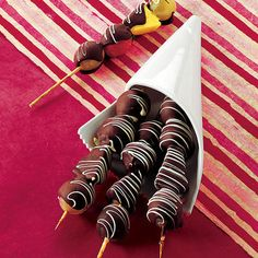 Chocolate covered fruit on skewers.