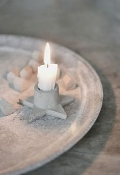 concrete candle holder - make the star out of concrete and add copper for the top