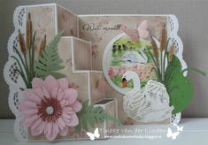 Handmade card by DT member Tineke with among others Creatables Petra's Waterlily (LR0406), Petra's Beautiful Border (LR0407), Tiny's Swan (LR0408), Tiny's Ferns (LR0403) and Tiny's Cattails (LR0409) from Marianne Design