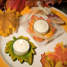 """Autumn Themed Candle Favor Here's an autumn themed candle favor that you can really FALL in love with Candles add warmth and atmosphere to any room and these candle favors will also add autumn flair to your event! As delicate as if they have just fallen from a grand autumn tree, each 3/4"""" x 3"""" x 2 ½"""" favor resembles a spectacular fall leaf in two colors – rust/yellow and green/yellow. Each has a rhinestone decorated poly resin leaf shaped base with a clear glass holder and white candle at…"""