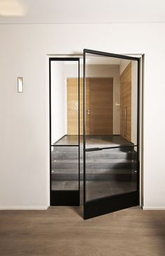 Swing door made of aluminum and glassRevolving glass door made of bronze-colored anodized aluminum with invisible self-closing pivot system. The design of the door is fully Trendy glass door frame Trendy Glass Door Steel Doors And Windows, Steel Frame Doors, Metal Doors, Interior Architecture, Interior Design, Interior Doors, Design Design, Design Interiors, Design Ideas