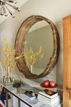 Wine Barrel Mirror - Clever and rustic! Home Depot sells whisky barrels for $30. Slice them and get an outdoor table with 3/4 of it and the top can be turned in…