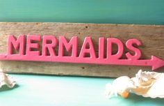 Rustic Wood and Cast Iron Nautical Mermaid Sign/ Hanger Wall Decor/ Coastal Decor Beach in Hot Pink. $45.00, via Etsy.