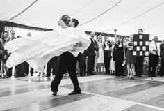 fantastic moment - groom lifts the bride during the first dance with cheers from the bridal party [marque wedding reception in Dorset]