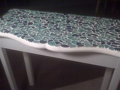 My next project! Got my table for 10.00 and my friend painted it shabby chic for me.  Now to put my sea glass on it!  SO EXCITED!