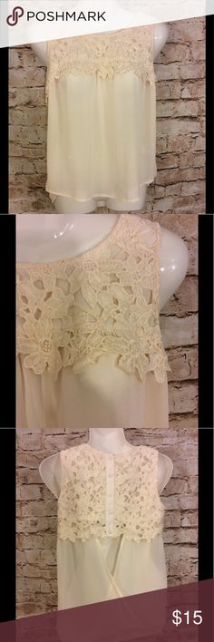 Altar'd state Cream lace top open/button back sz S Super cute altar'd state Cream colored floral lace open at base of  back with covered buttons at the top  Size small Length from top to bottom is 19 inches in the front 23 inches in the back Armpit to armpit is 17 inches This is an adorable little top would be perfect with a pair of jeans and cute sandals Altar'd State Tops Crop Tops