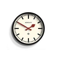 The Luggage wall clock in Gloss Black by Newgate Clocks. A small and contemporary railway station clock with modern marker dial. Iconic British design   www.newgateclocks.com  #homeware #decor #interior #homeaccesory