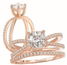 Rose Gold Diamond Engagement Ring with a Split Shank and Round Center Stone. Curved Diamond Matching Wedding Band