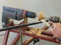 "Wood Lathe by Graeme -- Homemade wood lathe constructed from 1"" square tubing, flat bar, steel plate, a surplus drill chuck, and a hand drill. http://www.homemadetools.net/homemade-wood-lathe-25"